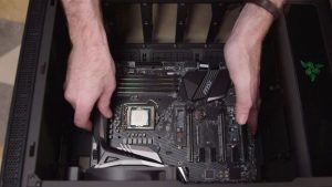 4. Install the motherboard standoffs in the PC case and screw in the motherboard